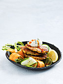 Corn and pancetta fritters with vegie ribbon salad