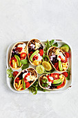 Taco shells with minced meat and vegetables