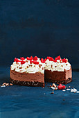 Chocolate mousse cake with coconut, cream and raspberries