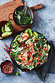 Warm sweet potato noodle salad with chicken and prawns