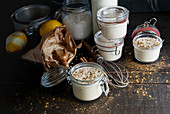 Glass jars with delicious sweet dessert of rice with milk and cinnamon