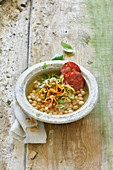 Vegetable noodle soup with chickpeas and chorizo