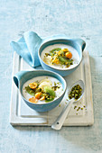 Sweet rice cream soup with exotic fruits and pistachios