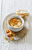 Tahini and lentil soup with yoghurt and black cumin
