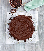 Nut cake with chopped almonds and chocolate icing