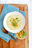 Potato cream soup with oat cream and marjoram