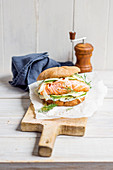 A salmon burger with cream cheese, fennel and capers