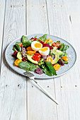 Waxy eggs on beetroot salad with cress