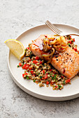Salmon fillet with quinoa, chia, peppers, and sweet onion sauce