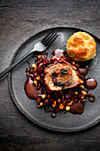 Stuffed roast pork with a potato flan and apple-red cabbage salsa