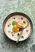 White tomato soup with basil foam and scallops