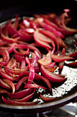 Caramelized red onions in a pan