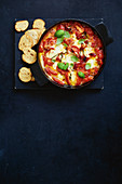 Hot tomato and mozzarella dip with basil