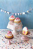 Candy cupcakes with cream cheese topping