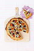 Cookie pizza with soft apricots, pistachios and cranberries