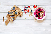 Poppy seed sesame buns and a berry smoothie bowl