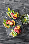 Bruschetta with beef fillet carpaccio and peaches
