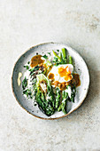 Roasted lettuce hearts, asparagus, and a poached egg