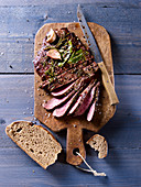 Grilled flank steak served with bread