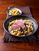 Saddle of wild boar with a lingon berry and beer sauce and potato orzo pasta