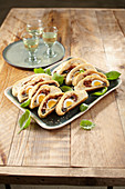 Stuffed bread wreath with Parma ham, cheese and basil
