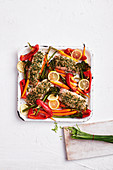 Quinoa-crusted salmon and vegie tray bake