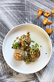 Chanterelle dumplings with bay bolete mushroom pesto