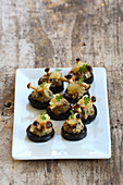 Velvet pioppini canapés with black pudding and pears
