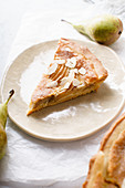A slice of tart with poached pears and almond frangipane