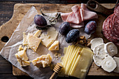 Cheese and meat board, snacks for wine with walnuts and honey