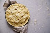 Uncooked apple pie with a wide lattice on top