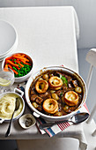 Beef stew with Yorkshire puddings, mashed potatoes and vegetables