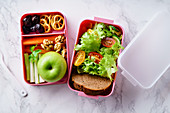 Lunch box with salad and healthy food for work and school
