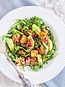 Arugula salad with sweet potatoes, avocado, pomegranate and grilled nuts