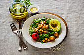 Healthy chickpeas salad with avocado, arugula, cherry tomato and parmesan