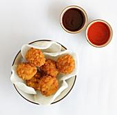 Shrimp balls on prawn crackers