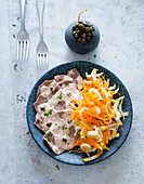 Vitello tonnato with a carrot and chicory salad