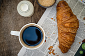 Croissant with Coffee on wooden board