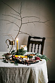 Holiday tablescape with chocolate bark, dried fruit, fruit and dip