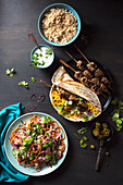 Lamb koftas with wrap, minted yoghurt, crunchy salad with coriander and jalapenos