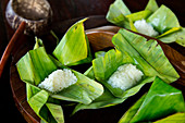 Sticky rice on banana leaf is a traditional thai street food sweet snack
