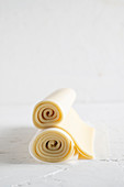 Raw, rolled puff pastry