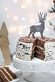 A Christmas chocolate cake decorated with a silver stag, sliced