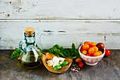 Tomato, mozzarella, basil leaves and olive oil for an Italian salad