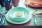 Turquoise place setting with a decorative stone