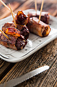 Bacon wrapped dates filled with cheese