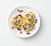 An omelette roll with bacon, mushrooms, ricotta and hazelnuts