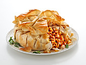 Fusilli bake with meat sauce and cheese in puff pastry
