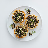 Lentil and apple salad in pastry bowls
