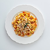 Tagliatelle with pumpkin, quince, cheese sauce and caramelised walnuts